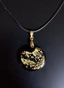 תליון עגול שחור-זהב